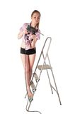 Woman with puncher on ladder Stock Photos