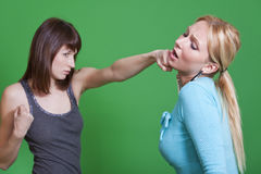 Woman punches in the face Royalty Free Stock Photo