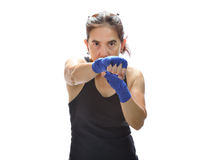 Woman punching boxing pads Royalty Free Stock Photos