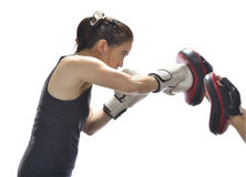 Woman punching boxing pads Stock Photo