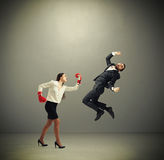 Woman punching businessman Stock Photos