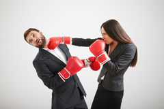 Woman punching businessman Stock Image