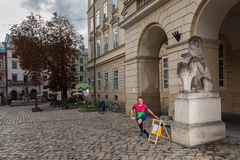 Woman punching at control point participating in orienteering competitions Stock Photography
