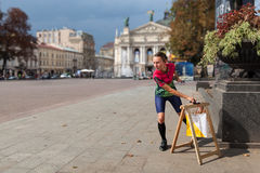 Woman punching at control point participating in orienteering competitions Royalty Free Stock Image