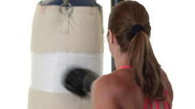 Woman Punching Heavybag stock video footage