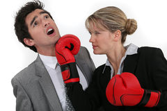 Woman punching her colleague Royalty Free Stock Photography