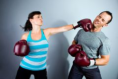 Woman Punching Man Royalty Free Stock Photography