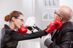 Woman punching a man on the face in a box match Royalty Free Stock Images