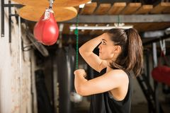 Woman punching a speed bag Royalty Free Stock Photography