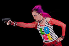 Woman In punk clothing aiming a gun Royalty Free Stock Photography
