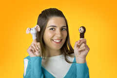 Woman with puppets. Beautiful woman playing with puppets on the fingers Royalty Free Stock Image