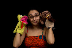 Woman with puppets. Woman playing with puppets on hands. Isolated on black background Royalty Free Stock Images