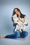 Woman and puppies Royalty Free Stock Photography