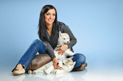 Woman and puppies Stock Image