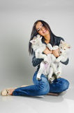 Woman and puppies Stock Images
