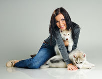 Woman and puppies Royalty Free Stock Images