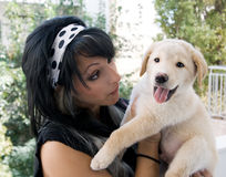 Woman and puppy Royalty Free Stock Image