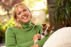 Woman and Puppy Enjoying Their Day on The Sofa Stock Photography