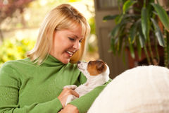 Woman and Puppy Enjoying Their Day on The Sofa Royalty Free Stock Photo