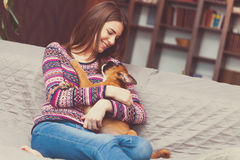 Woman with a puppy Royalty Free Stock Photography