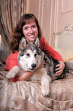 Woman with a puppy Malamute Stock Photography