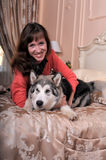 Woman with a puppy Malamute Stock Photo