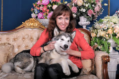 Woman with a puppy Malamute Royalty Free Stock Photo