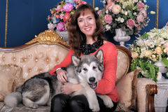 Woman with a puppy Malamute Royalty Free Stock Photography