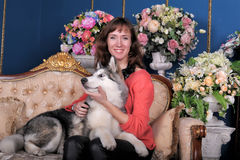 Woman with a puppy Malamute Stock Photos