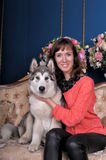Woman with a puppy Malamute Stock Images