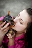Woman and puppy Stock Photo
