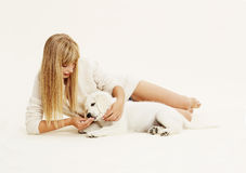Woman and puppy Stock Images