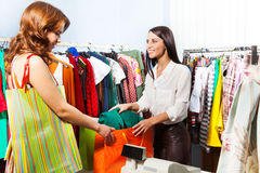 Woman with purchase after paying at cashiers desk Royalty Free Stock Photography