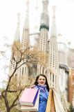 Woman   with purchases against Sagrada familia Royalty Free Stock Image