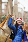 Woman with purchases against Sagrada familia Stock Photos