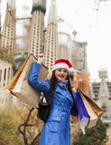 Woman with purchases against Sagrada familia Stock Photography
