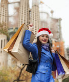 Woman with purchases against Sagrada familia Stock Photo