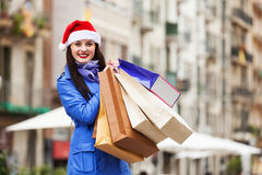 Woman with purchases during the Christmas sales Royalty Free Stock Image