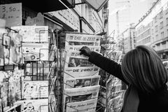 Woman purchases a Die Zeit german newspaper from a newsstand Royalty Free Stock Photography
