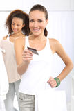 Woman on purchases paid by credit card. Stock Photos