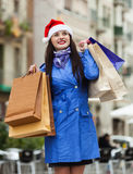 Woman with purchases at street Stock Photo