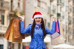 Woman with purchases at street Royalty Free Stock Image