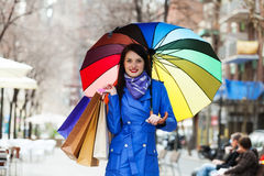 Woman with purchases at street Stock Images