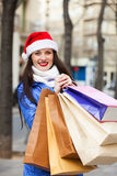 Woman with purchases at street Royalty Free Stock Images