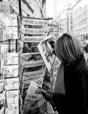 Woman purchases a Suddeutsche Zeitung german newspaper from a ne Stock Photo