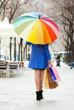 Woman  with purchases and umbrella at street Royalty Free Stock Photography