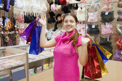 Woman with purchases in underwear shop Stock Image