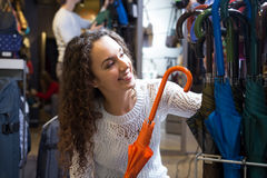 Woman purchasing automatic umbrella Stock Photo