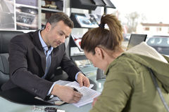 Woman purchasing the car form car dealer Stock Photo