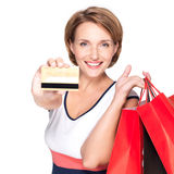 Woman with purchasing  and credit card Royalty Free Stock Photography